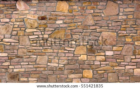 stone wall of natural stone freeform close-up #551421835
