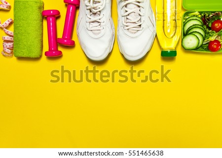 Healthy lifestyle, food, sport or athlete's equipment on bright background. Flat lay. Top view with copy space. Royalty-Free Stock Photo #551465638