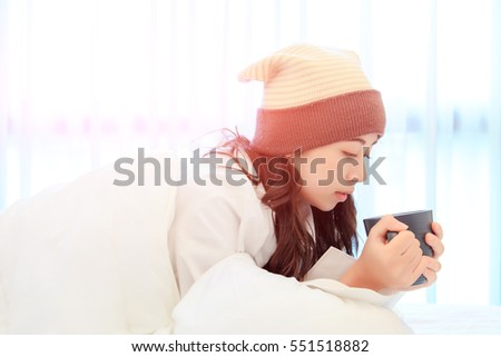 Portrait of a beautiful young lady drinking her morning coffee in her bedroom #551518882
