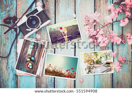 Photo album in remembrance and nostalgia of Happy easter day in spring on wood table. instant photo of vintage camera - vintage and retro style
