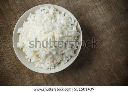 Bowl of steamed rice organic on wooden table #551601439