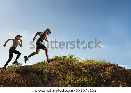 Trail Runner of men and women running on the mountain #551675152