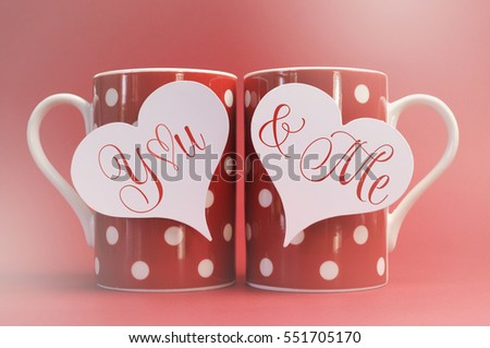 You and Me, love message greeting on heart gift tags on red polka dot coffee mugs for Valentines Day, Mothers Day, birthday, wedding or loving occasion, with applied faded retro style filters..