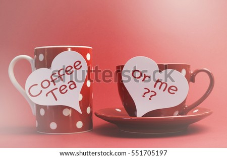 Coffee, Tea or Me messages on red polka dot mug and tea cup and saucer against a red background for a bright, fun and cheerful Valentines Day with applied faded retro style filters.