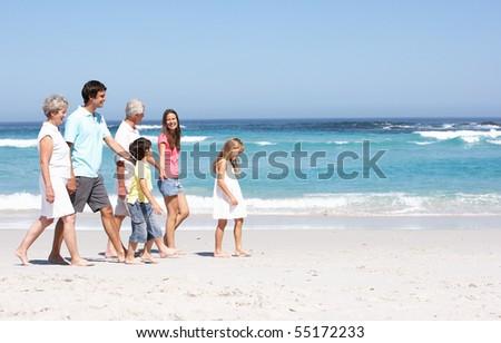 Three Generation Family Walking Along Sandy Beach #55172233