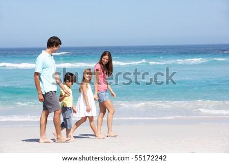 Family Walking Along Sandy Beach #55172242