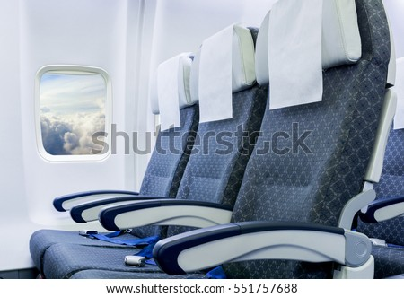 Airplane seats in the cabin economy class Royalty-Free Stock Photo #551757688