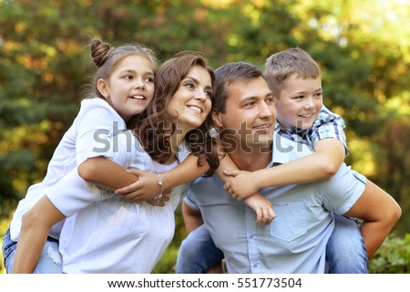 Parents giving children piggybacks #551773504