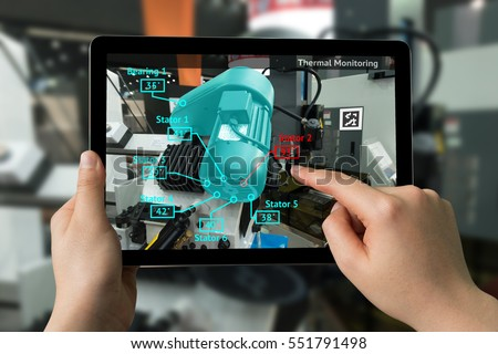 Industrial 4.0 , Augmented reality concept. Hand holding tablet with AR service , Thermal Monitoring motor application for check destroy part of smart machine in smart factory background #551791498