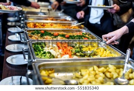 Cuisine Culinary Buffet Dinner Catering Dining Food Celebration Party Concept. Group of people in all you can eat catering buffet food indoor in luxury restaurant with meat and vegetables. Royalty-Free Stock Photo #551835340