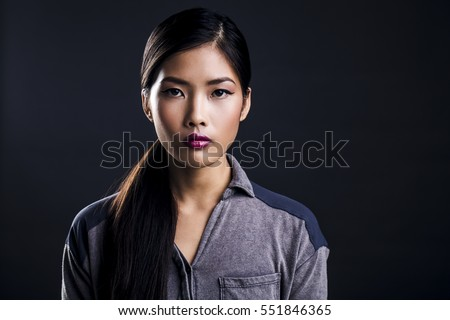 Portrait of Beautiful Young Asian Woman Being Serious #551846365