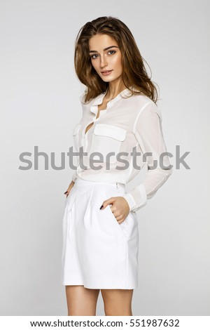 Beautiful female model posing in white clothes #551987632