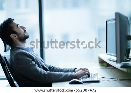 Overworked tired employee at workplace in office being unhappy #552087472