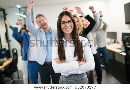 Happy business people celebrating success at company #552090199