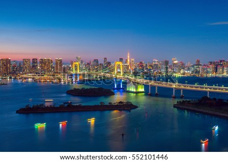 Tokyo skyline with Tokyo tower and rainbow bridge at sunset in Japan #552101446