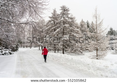Montreal, CA - 4 January 2017: Winter snowy landscape in Montreal, Quebec (Botanical Garden) #552105862
