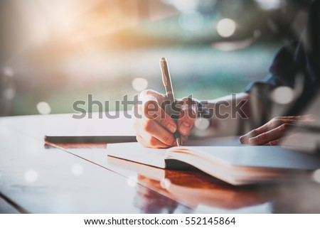 People writing on notebook and work with calculator and laptop on wooden table #552145864