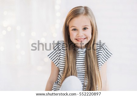 Laughing cute girl portrait #552220897