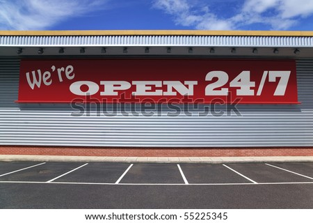 Billboard on a retail building with notice saying  We're open 24/7