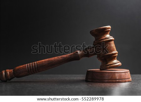 Judge's Gavel over black background