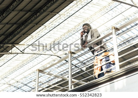 Businessman in the Train Station. Business Concept #552342823