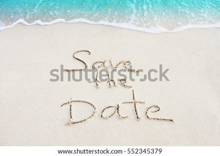 Save The Date handwritten on sand, beach with ocean wave on background #552345379