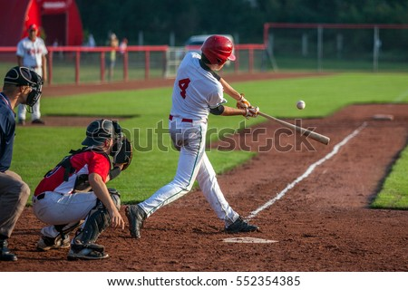 Baseball batter hits the ball #552354385