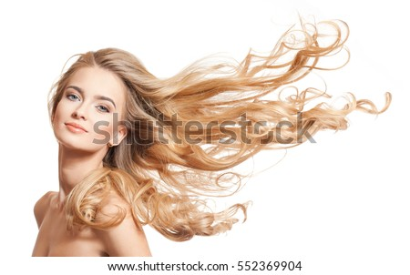 Portrait of a young blond woman with long healthy hair.