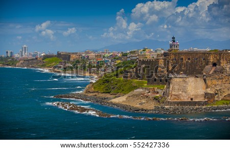 Scenic view of historic colorful Puerto Rico city in distance with fort in foreground Royalty-Free Stock Photo #552427336