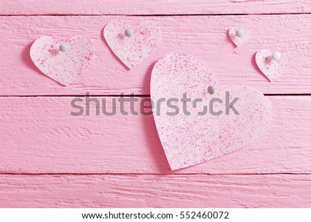 pink heart made of paper on wooden background #552460072