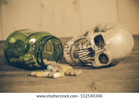 human skull with drugs on wood #552540340