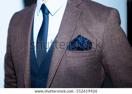 men suit perfect to the last detail.Man posing in brown suit  #552619426