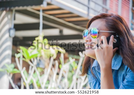 Portrait of young hipster woman relaxing on a balcony on a sunny summer. Smiling enjoy with nature. #552621958