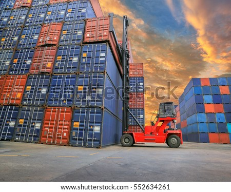 Forklift truck lifting cargo container in shipping yard  for transportation import export business. #552634261