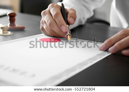 Notary public in office signing certificate #552721804