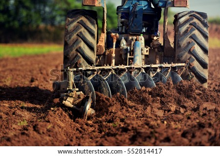 Agricultural workers with tractors Royalty-Free Stock Photo #552814417