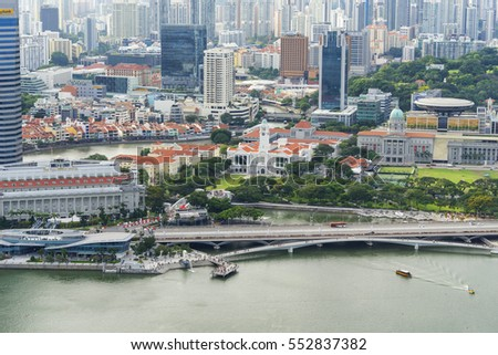 Singapore - December 12, 2016 : high view of city landscape building at Marina Bay from sky park of Marina Bay Sands, Singapore #552837382