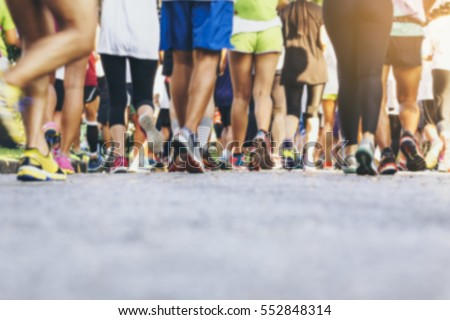 Marathon runners Crowd People Race Outdoor Sport Training #552848314