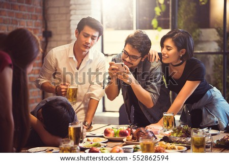 Group of friends taking pictures people who are intoxicated from drinking the Asians.
