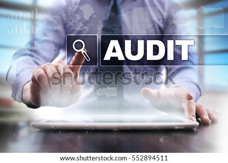 Businessman using tablet pc and selecting audit. #552894511