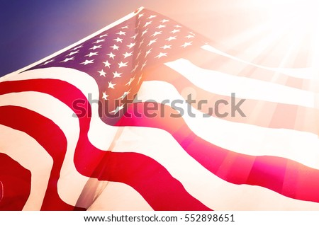 Flag of the USA with sunflare #552898651