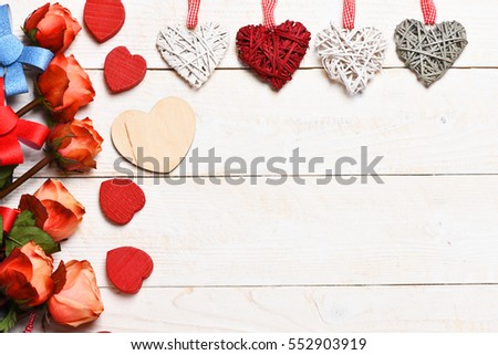 beautiful valentines day set with roses, bows, heart symbol on vintage wooden background, copy space #552903919