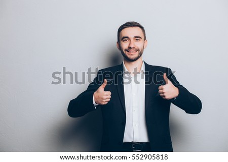 Young businessman in suit thumbs up  isolated #552905818