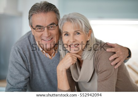 Portrait of senior couple looking at camera #552942094