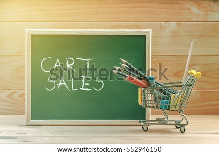 Cart sales text display on chalkboard with shopping cart #552946150
