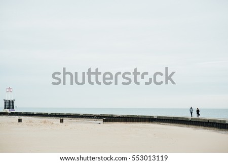The Couple Walking on a Bridge with Lake and Blue Sky #553013119