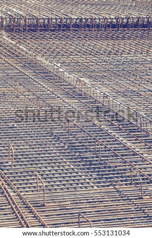 Iron bars background, before foundation pouring begins. Selective focus and vintage style. #553131034