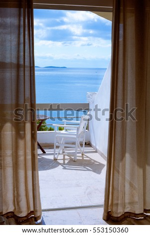 Hotel room with a sea view house near the sea in the environmental and green location on the island. The window overlooking the ocean. The endless expanse of the sea. Place for a romantic holiday. #553150360