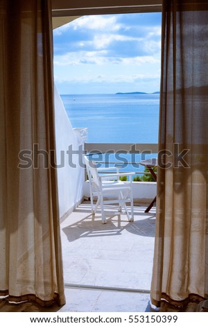 Hotel room with a sea view house near the sea in the environmental and green location on the island. The window overlooking the ocean. The endless expanse of the sea. Place for a romantic holiday. #553150399