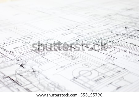 A close-up of an architectural blue print with black and white details, marked by measurements and construction and design details. Royalty-Free Stock Photo #553155790